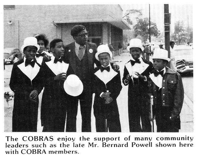 Bernard Powell pictured with some members of the Marching Cobra.