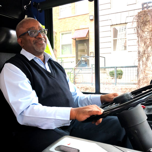 RideKC operator Fred Ersery sits behind the wheel of a bus.