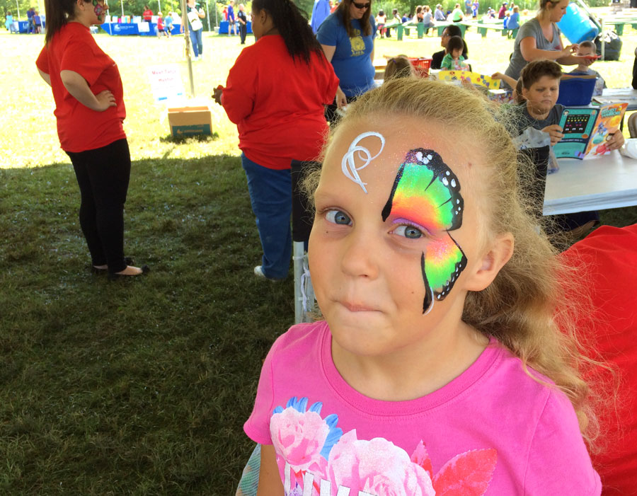 Face painting at Library in the Park