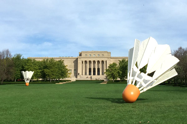 The Nelson Atkins Museum sculpture garden. Pictured are the museum building, shuttlecocks sculptures and expansive green lawn.