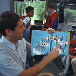 KCK Public Library brings award-winning book to life on board bus