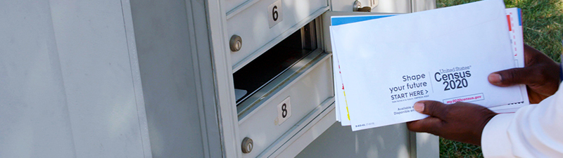 Census being put into a mailbox