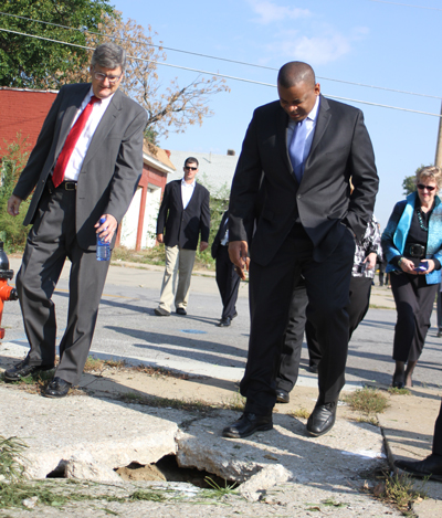 Former Transportation Secretary Fox looks at sidewalk conditions on Prospect