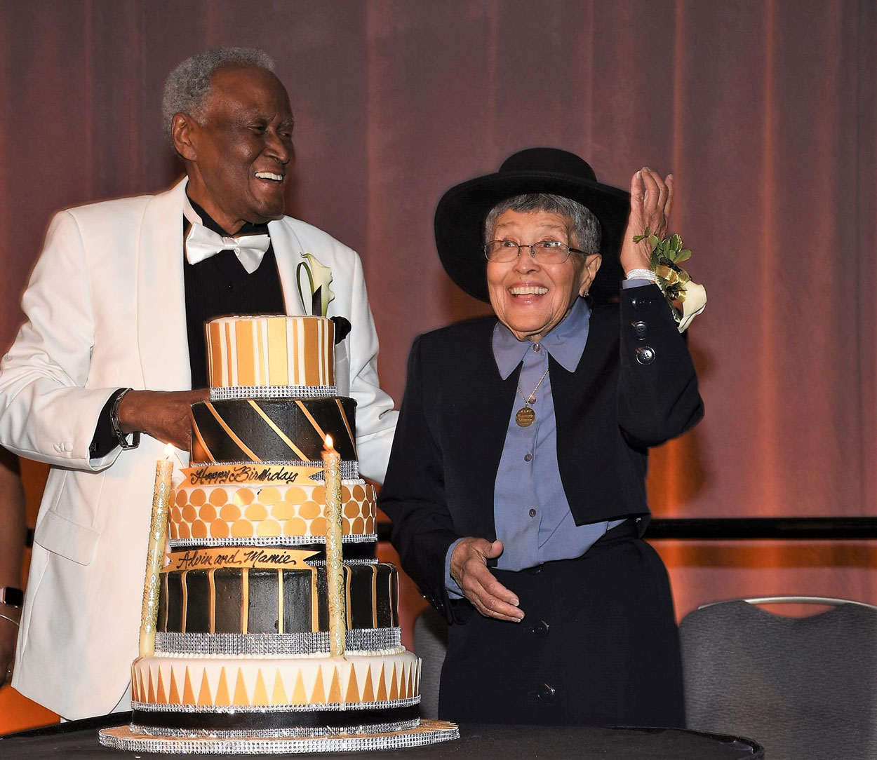 Alvin Brooks and Mamie Hughes share a birthday cake