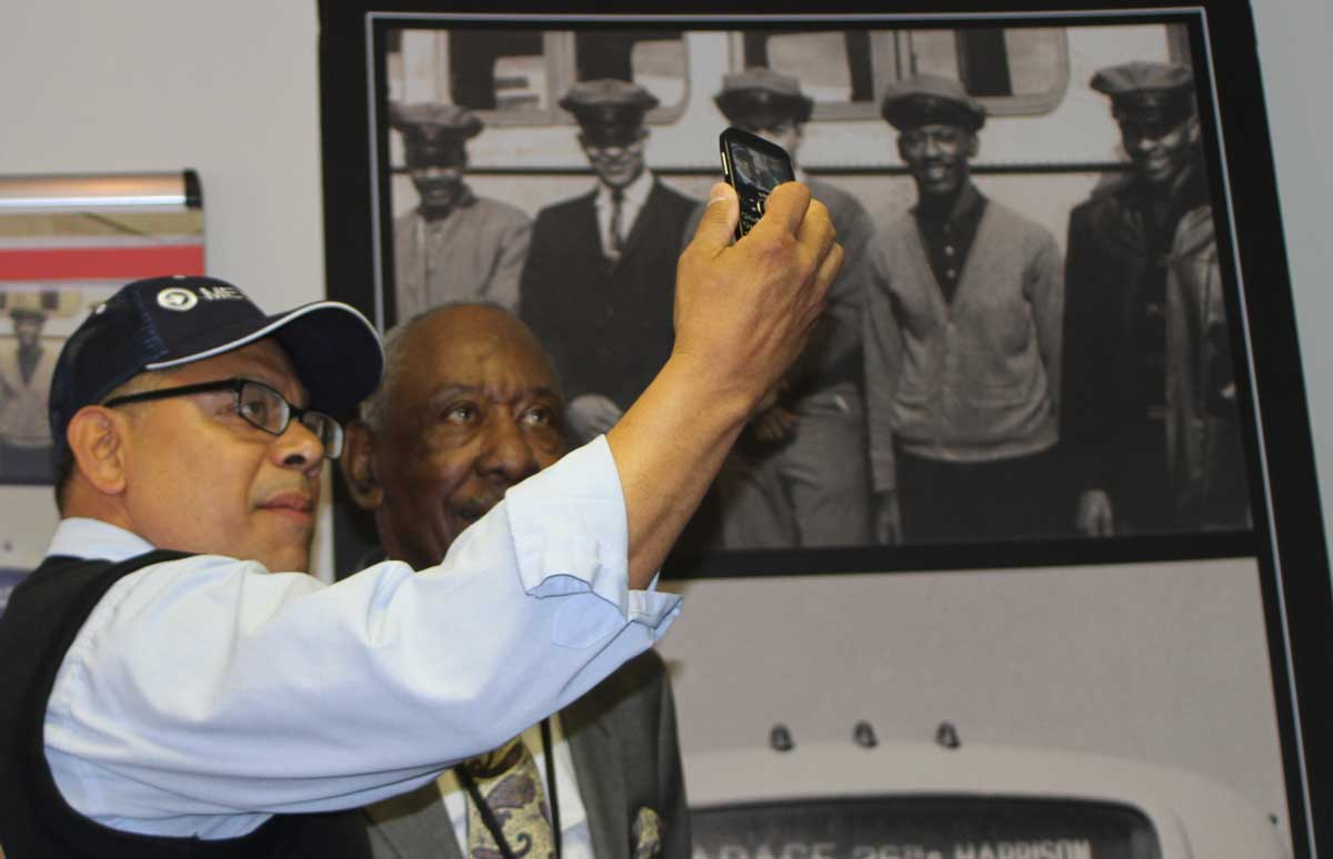 A bus operator takes a selfie with Ray Harris.