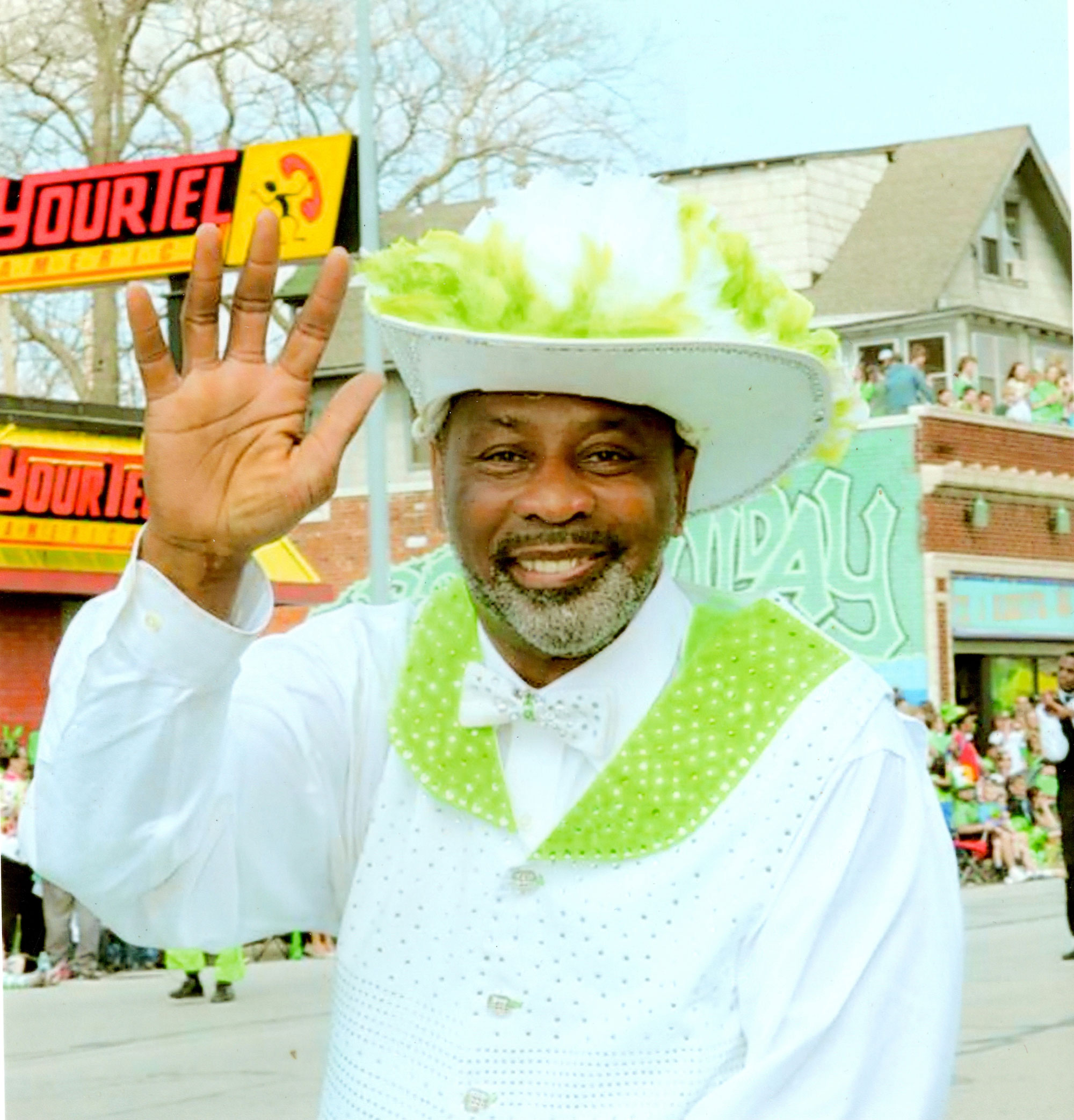 Close up photo of a smiling Willie Smith as he leads the Marching Cobras in a parade
