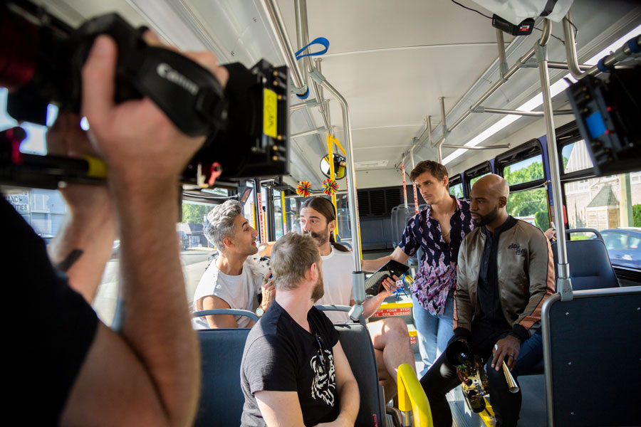 On a RideKC bus, a camera films the cast of the television show Queer Eye.