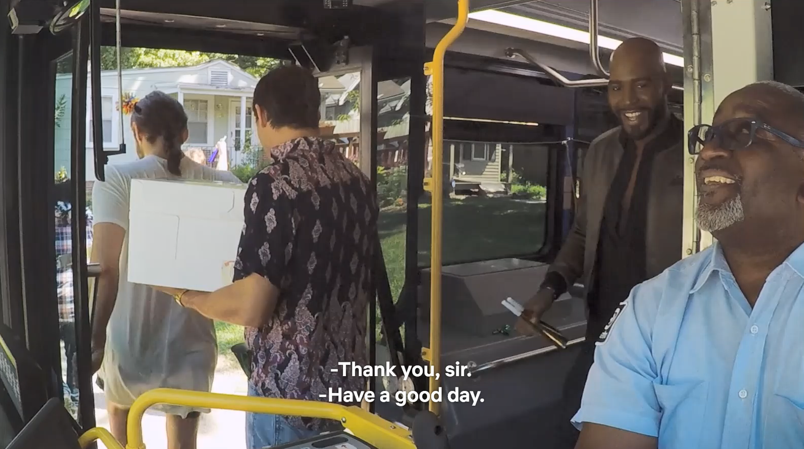 Queer Eye star Karamo thanks bus driver Fred Ersery as Karamo exits the RideKC bus.